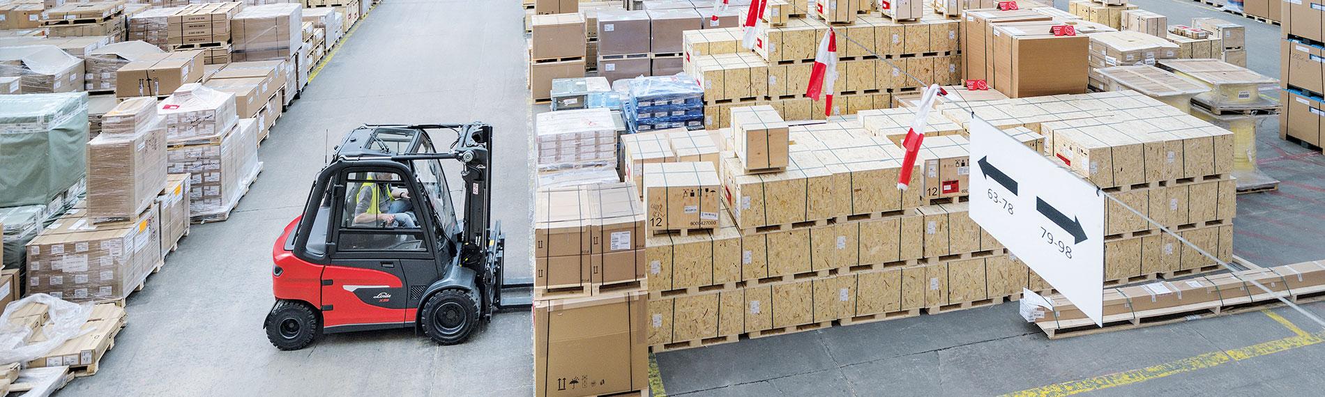 linde x20 x35 in warenhaus gabelstapler von holzkisten umgeben